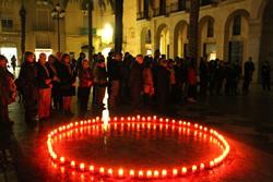 Planta d'espelmes contra la violència vers les dones